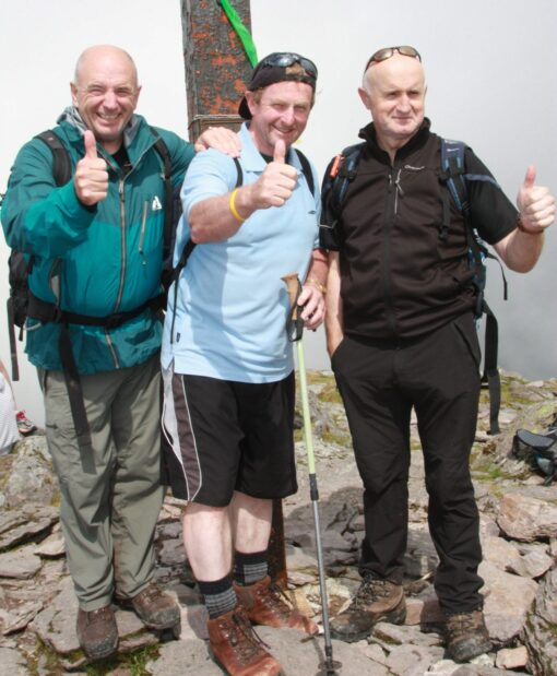Enda Kenny Taoiseach of Ireland (Prime Minister) 2011 to 2017 on the Summit of Ireland's highest Mountain with guide and explorer Pat Falvey and Joe O'Leary.